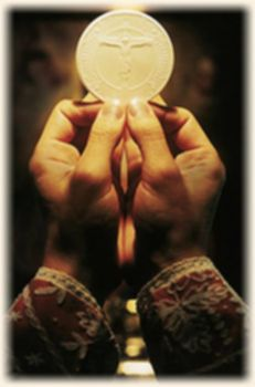 파일:external/www.institute-christ-king.org/eucharist_hand.jpg